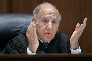 California Supreme Court Chief Justice Ronald M. George gestures as he speaks during a session at the California Supreme court March 4, 2008 in San Francisco, California.