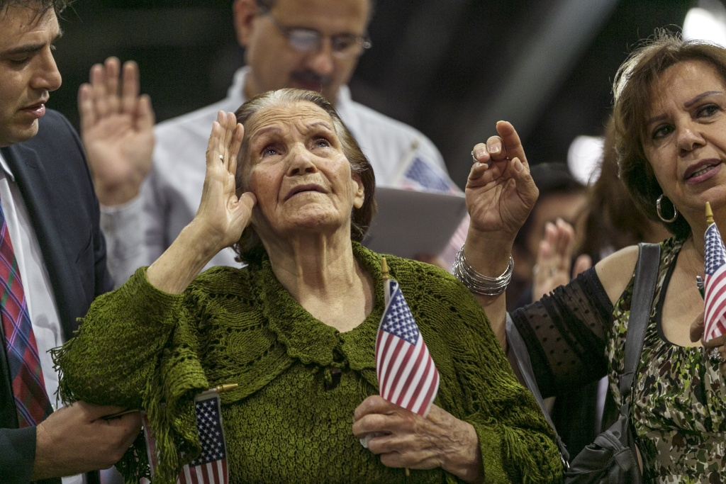 New American Khatoun Novasartian Khoykani, a 99-year-old woman from Iran  pledges alliance with nearly 7,500 other people becoming U.S. Citizens at the L.A. Convention Center in Los Angeles Friday, July 26, 2013.