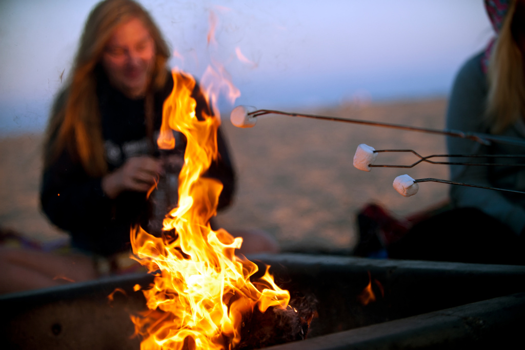 Newport Beach has withdrawn an application to the California Coastal Commission to remove five dozen fire rings from the city's beaches, but the bonfire battle isn't over. The South Coast Air Quality Management District has scheduled a vote on fire ring regulations July 12.