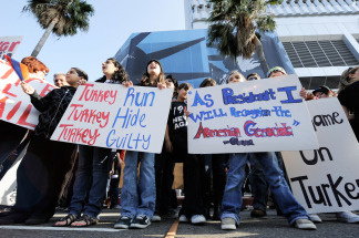 Armenian activists rally outside the Turkish Consulate General on the 94th anniversary commemoration of the Armenian Genocide on April 24, 2009 in Los Angeles, California. The Armenians and Turkish officials disagree over the use of the term genocide in describing the mass killings of Armenians in 1915. Ottoman authorities arrested about 250 Armenian intellectuals and leaders in Constantinople in April 24, 1915 just before the Ottoman military forced Armenians to march hundreds of miles to what is now Syria. Massacres and sexual attacks against the Armenians were widespread. The Armenian Genocide is the second most-studied case of genocide after the Holocaust.