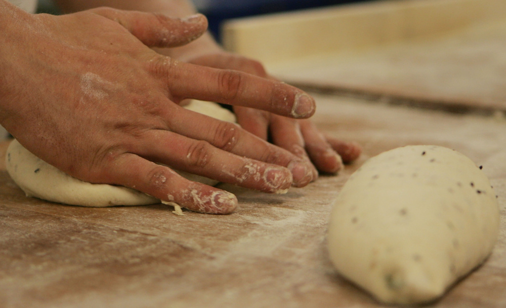 File: A worker shapes a loaf on Aug. 5, 2008 in London, England.