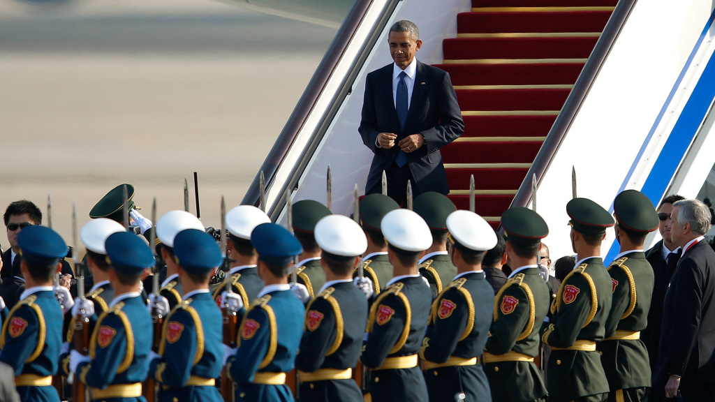 President Obama arrives at the Beijing airport Monday. Speaking at the APEC summit, the president unveiled a new deal to ease visa restrictions between the U.S. and China.