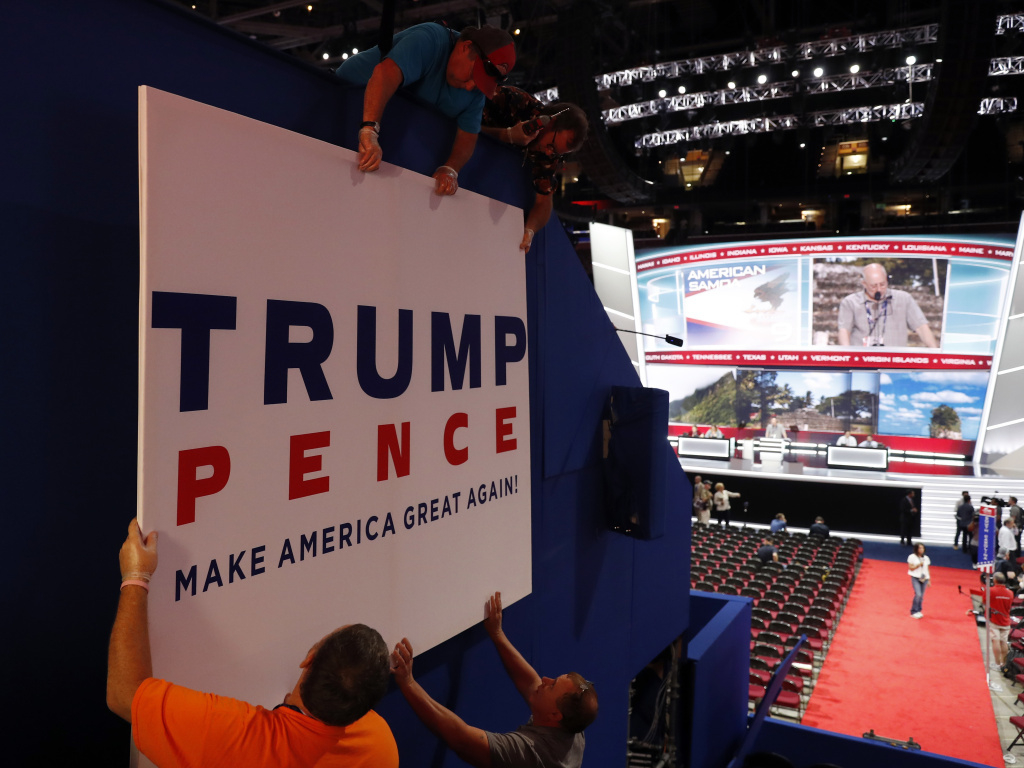 Workers place a sign Sunday, July 17, as they prepare for the Republican National Convention this week in Cleveland.