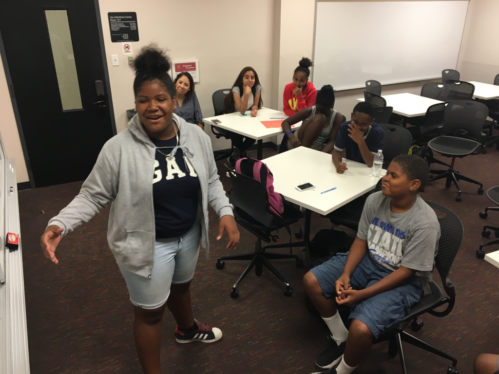 Samone Urasia Wade, 13, performs a poem about race and social justice she and a group of fellow seventh- and eighth-graders wrote together in a small classroom on the University of Southern California campus.