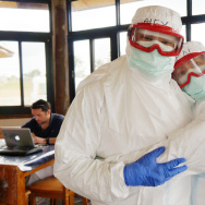 "How do siblings get around the ""no touching"" rule during the Ebola outbreak in Sierra Leone? Alex and Jen Tran grabbed a rare hug when they were geared up for training."