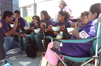 Janitors eat their last meal on Tuesday, Aug. 24, 2010 before fasting for three days outside the Century City JP Morgan. Members of the Service Employee Union are calling on JP Morgan Chase to give janitors their jobs back.