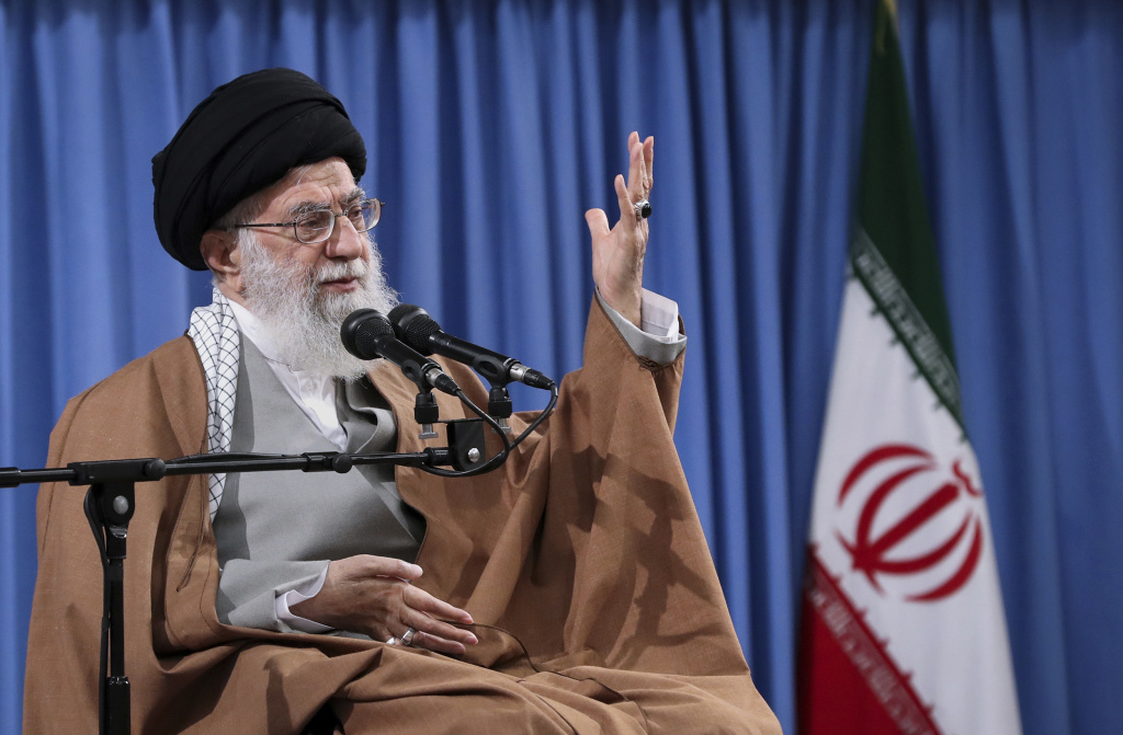 Iran's supreme leader, Ayatollah Ali Khamenei, speaks with a group of Revolutionary Guards and their families in Tehran on April 9. Tensions between Iran and the U.S. have escalated recently following Iran's shootdown of a U.S. drone and U.S. cyberattacks against an Iranian intelligence group. On Monday, President Trump announced financial sanctions against Khamenei and other top officials.