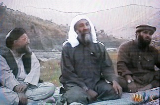 This frame grab from the Saudi-owned television network MBC (Middle East Broadcasting Center) shows alleged terror mastermind Osama bin Laden sitting between his Egyptian lieutenant Ayman al-Zawahri (L) and Suleiman Abu Ghaith, the spokesman of his al-Qaeda network, in an undated videotape broadcast by the Dubai-based MBC April 17, 2002.