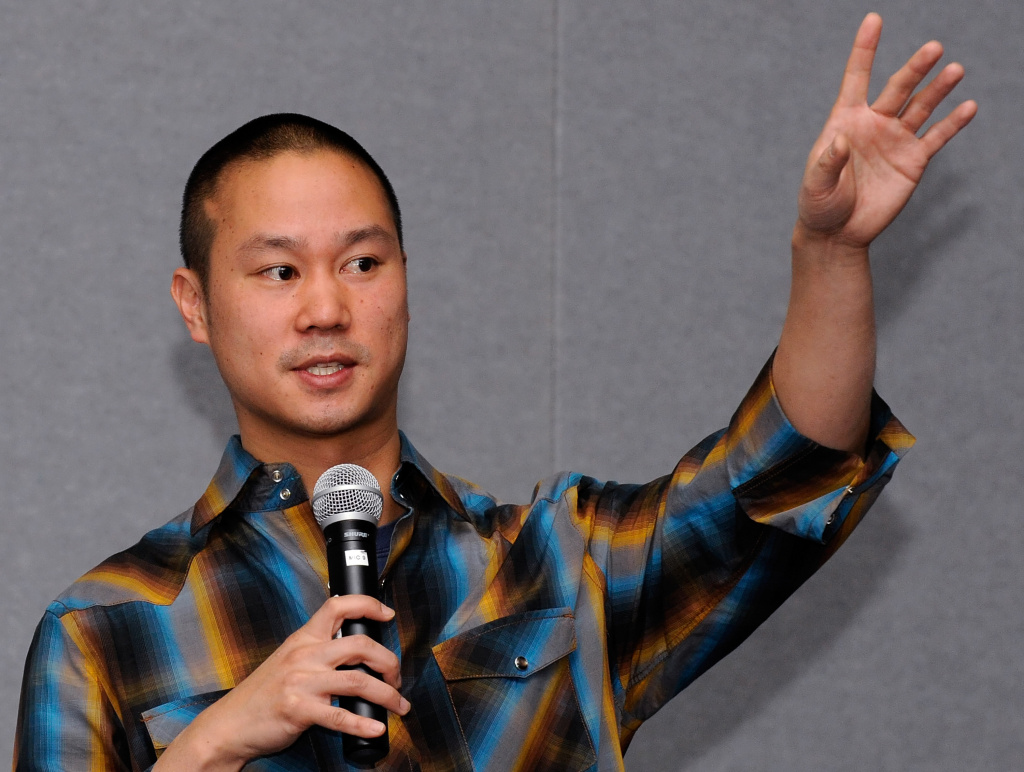 Zappos.com CEO Tony Hsieh delivers a keynote presentation at the MAGIC clothing industry convention in the Las Vegas. Don't worry about the tax breaks, he suggests to the states, because companies may have already made up their minds about where they want to be.