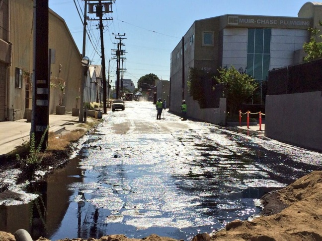 Crude oil being cleaned up on Brazil Street after an oil spill in Atwater Village on Thursday, May 15, 2014.
