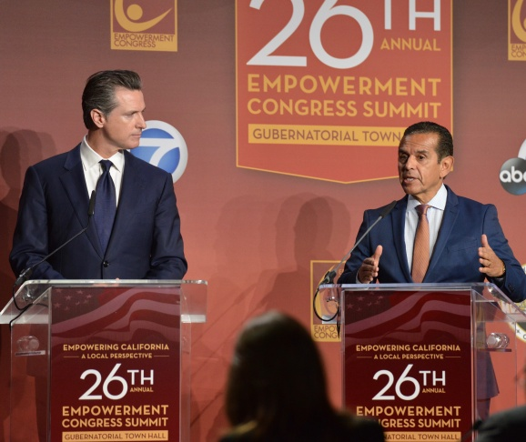 FILE: Lt. Gov. Gavin Newsom, left, and former Los Angeles Mayor Antonio Villaraigosa appear at the 26th Annual Empowerment Congress Summit gubernatoral town hall on Jan. 13, 2018 at USC.