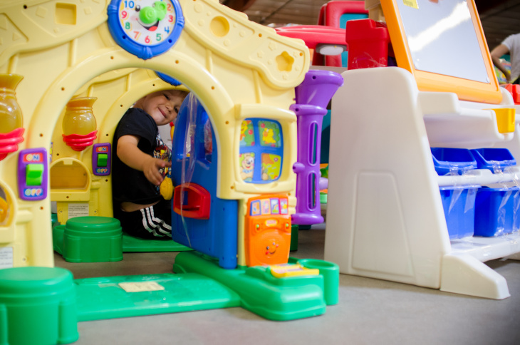 Erich Soendker, 3, plays through a path of doorways as his mother shops for costumes, cleats and winter clothes during the presale at LA Kids Consignment in Burbank, Calif., Wednesday, September, 19, 2012. The consignment includes clothing, toys, books and other items at discounted prices and will be open to the public from Thursday to Sunday.