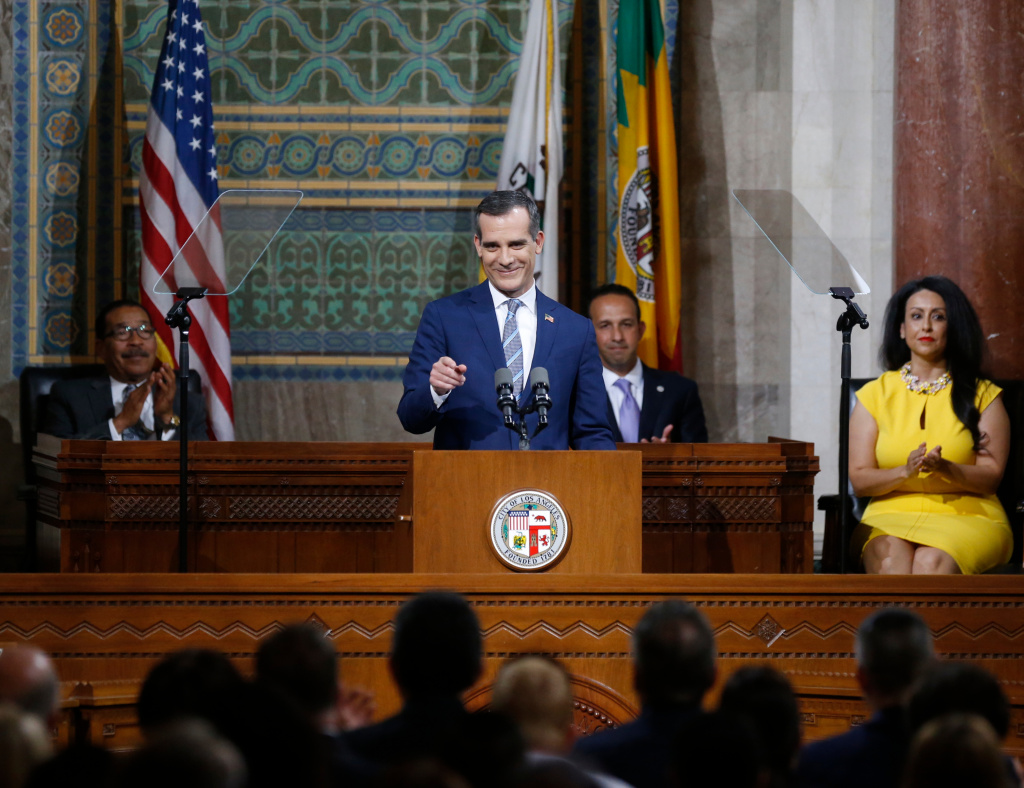 Los Angeles Mayor Eric Garcetti, center, delivers his State of the City address at City Hall on Monday, April 16, 2018.