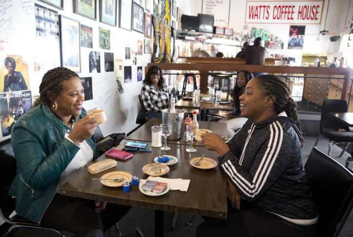 BaVette Anderson, right, and Henrietta Johnson settle in for breakfast at the Watts Coffee House.