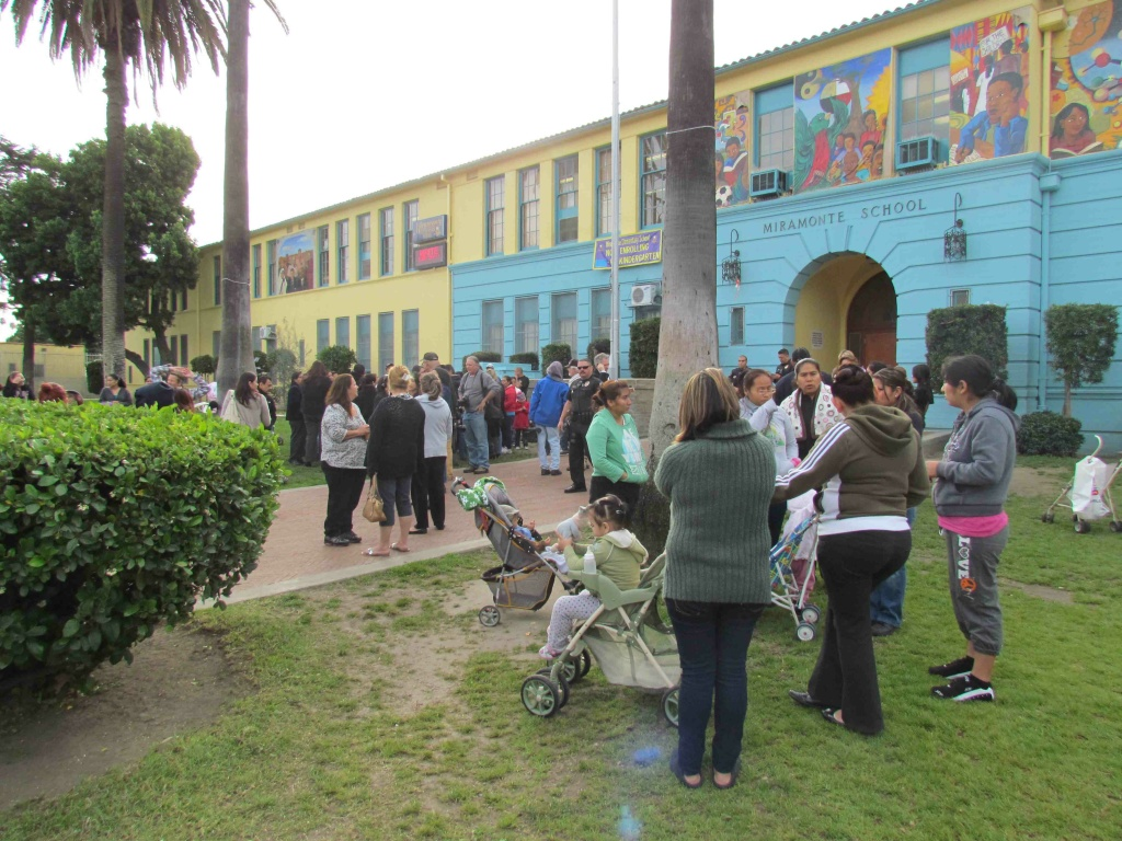 Parents protest at Miramonte Elementary School in South LA Monday.