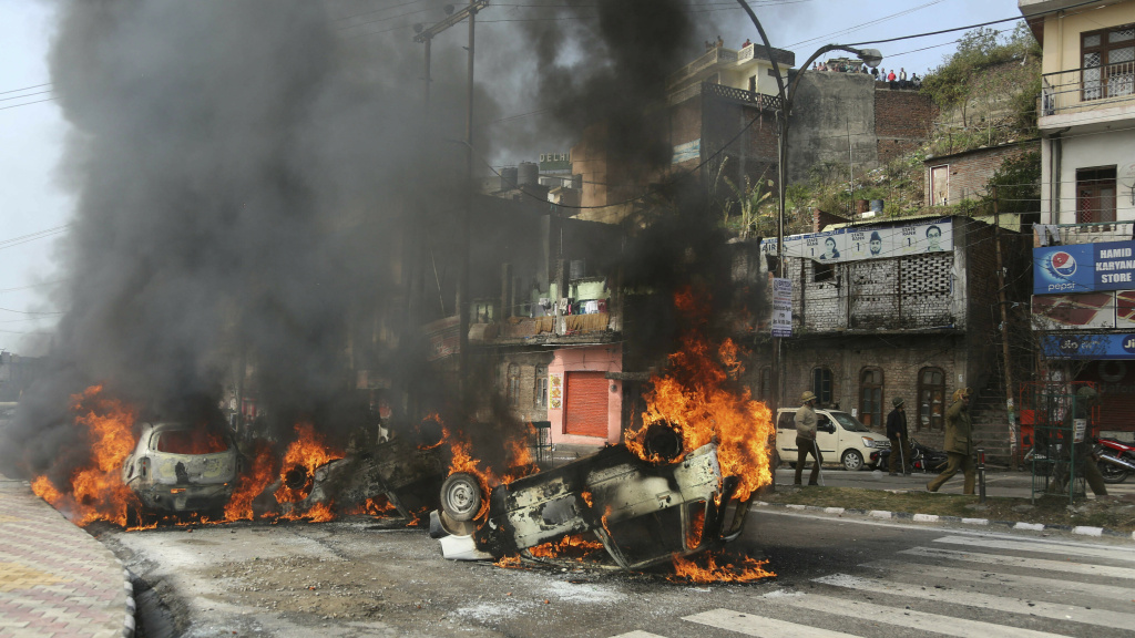A mob in India set fire to vehicles on Friday, in protest of Thursday's attack on a paramilitary convoy in Kashmir.