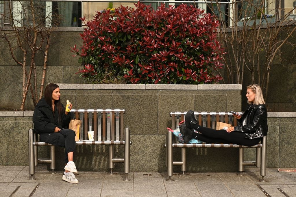 Two friends enjoy their lunch together at a safe distance in central Leeds.