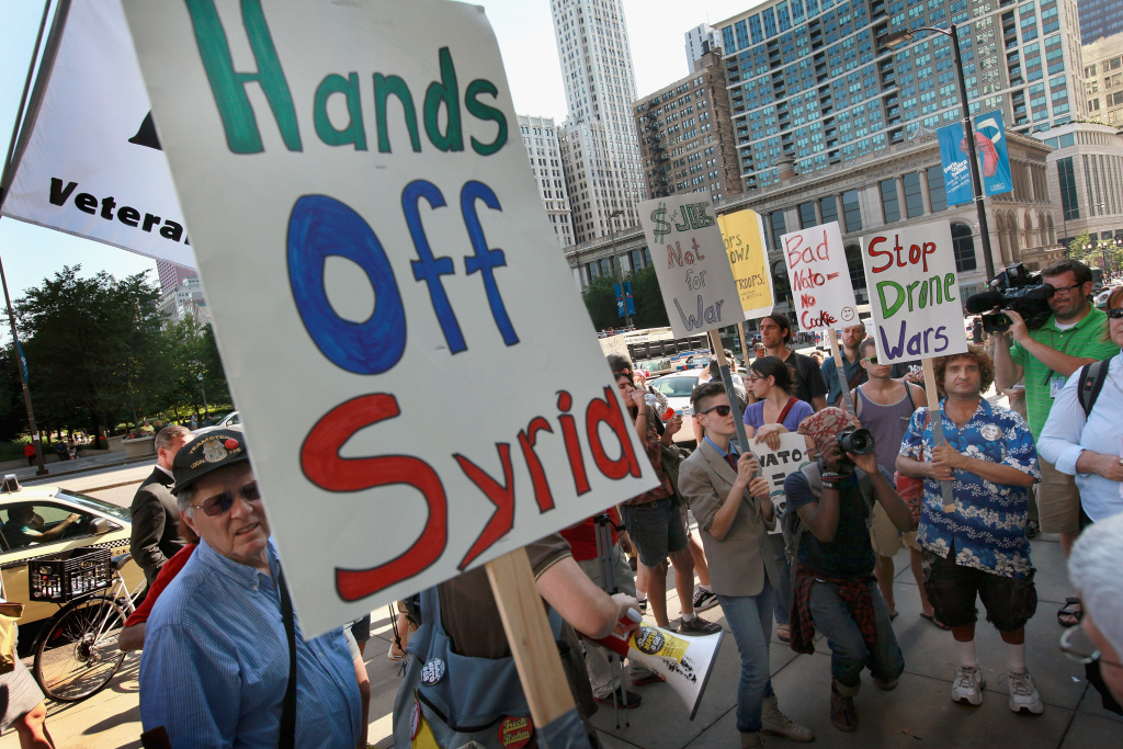 Demonstrators protest against military intervention in Syria outside President Barack Obama's national campaign headquarters on June 26, 2012 in Chicago, Illinois. The protest, organized by a coalition of anti-war groups, was held today to coincide with an emergency meeting NATO was holding to consider military action in Syria.