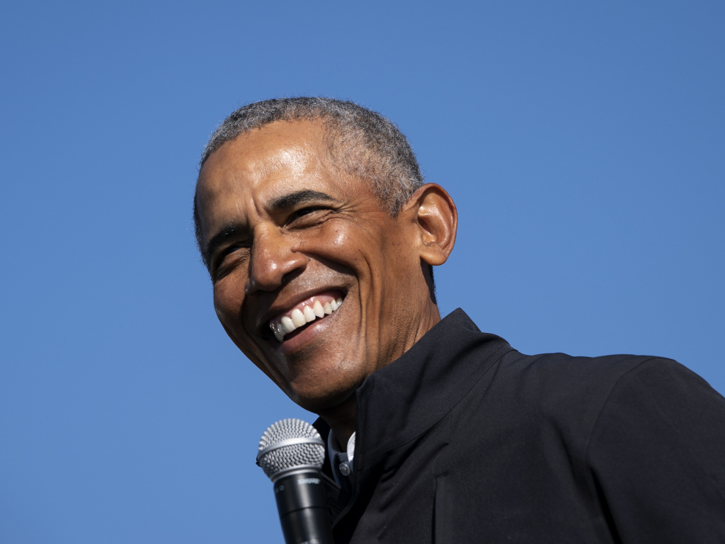 Former President Barack Obama speaks during a drive-in campaign rally for Joe Biden on Oct. 31 in Flint, Michigan.