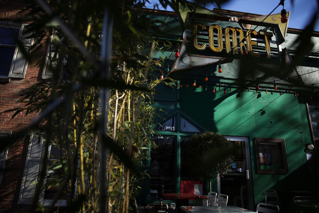 The sign and front entrance of Comet Ping Pong pizzeria are seen on Connecticut Avenue December 5, 2016 in Washington, DC.