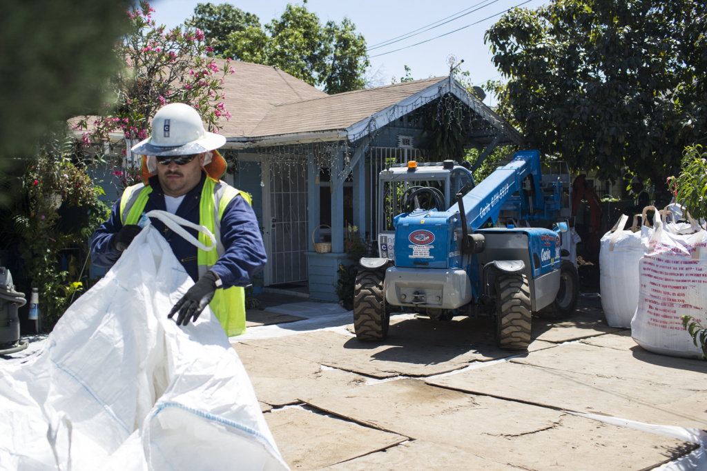 Crews remove soil in April 2016 from an East L.A. home in an earlier phase of the state's Exide cleanup.