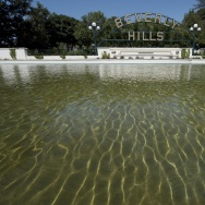 The Beverly Hills lily pond with the city's famous sign is seen during a severe drought in Beverly Hills,  California on April 9, 2015.  On average wealthier neighborhoods like Beverly Hills consume three times more water than less affluent ones, according to the study by researchers at the University of California Los Angeles (UCLA), and the Governor is calling for a reduction in water consumption by 25% statewide.