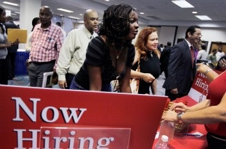 Ida Aka speaks with a job recruiter from Bank of America at a job fair in the James L. Knight Center on August 23, 2011 in Miami, Florida.