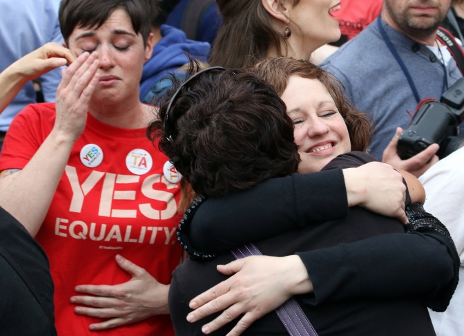 Supporters react outside Dublin Castle following the result of the same-sex marriage referendum in Dublin on May 23, 2015. Ireland on Saturday became the first country in the world to approve gay marriage by popular vote as crowds cheered in Dublin in a spectacular setback for the once all-powerful Catholic Church.