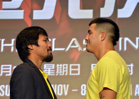 Philippine boxing icon Manny Pacquiao (L) and Brendon Rios of the US pose for photographers during a pre-fight press conference in Beijing on July 30, 2013. The pair will fight in a welterweight bout in Macau on November 24.