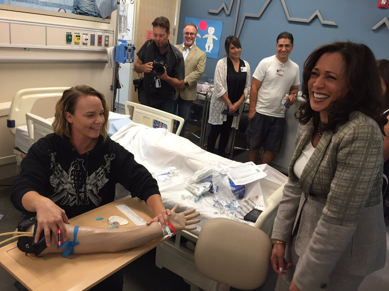 Kamala Harris and Ginger Parrish of Modesto, a first semester nursing student at Modesto Junior College the nursing students are learning how to insert IVs.