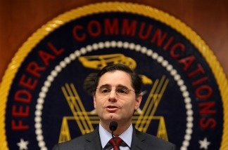U.S. Federal Communications Commission Chairman Julius Genachowski speaks to the media on the importance of net neutrality at the headquarters of the FCC in Washington, DC. Genachowski outlined a framework for broadband internet service providers that would prohibit them from blocking or limiting lawful online content.