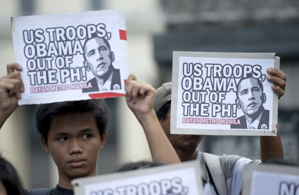 Activists hold an anti US protest in Manila on April 25, 2014. Protesters said that they will welcome US President Barack Obama with protests and that US troops are not welcome in the Philippines.