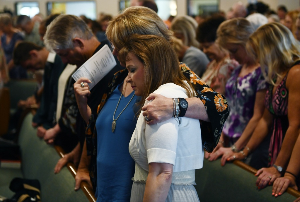 Worshippers attend a May 20, 2018 mass at Arcadia First Baptist Church in memory of the Santa Fe High School shooting victims, in Santa Fe, Texas.
