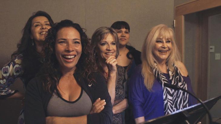 Cast of 'Now En Español' in the dubbing studio.