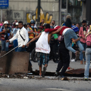 Venezuelan opposition demonstrators block the avenue during a protest against President Nicolas Maduro, in Caracas, on July 6, 2017.