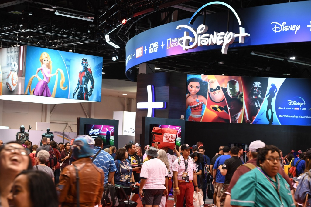 Attendees visit the Disney+ streaming service booth at the D23 Expo at the Anaheim Convention Center in Anaheim, California.