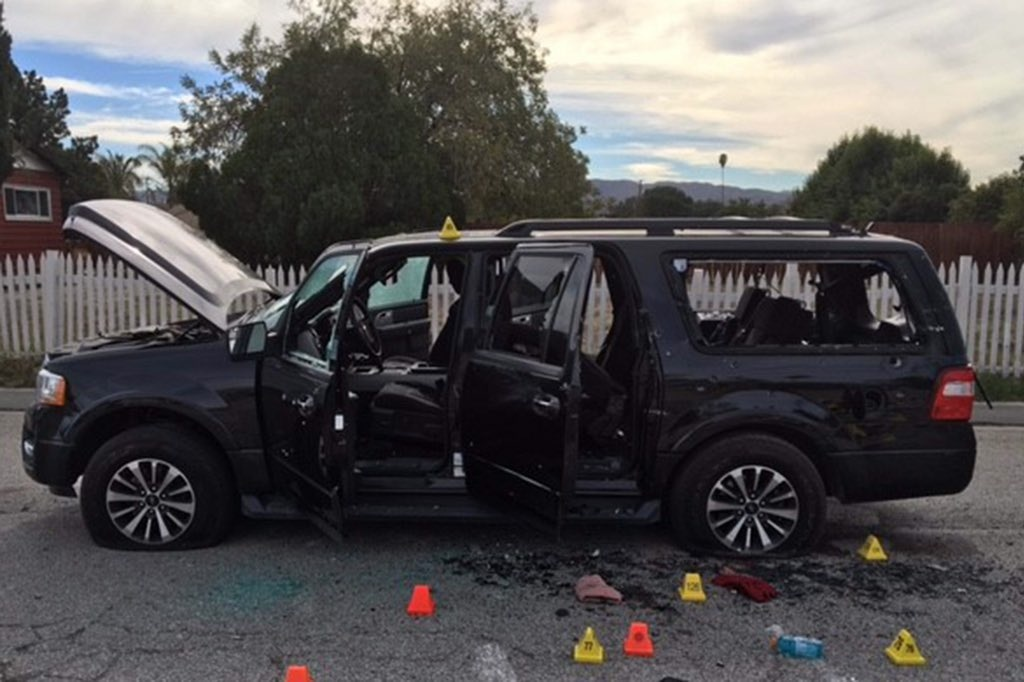 File: The black SUV driven by the two San Bernardino shooting suspects shot and killed by police.