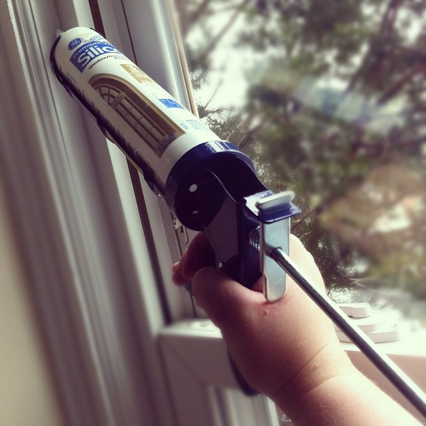 Caulking windows at your home is one way to prepare for keeping the El Niño rain outside, so you can stay warm and dry.