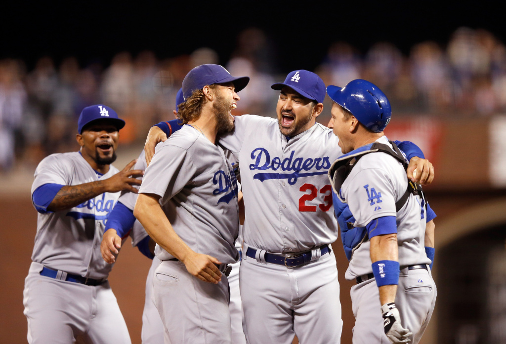 SAN FRANCISCO, CA - SEPTEMBER 29:  (L-R)  Clayton Kershaw #22, Adrian Gonzalez #23 and A.J. Ellis #17 of the Los Angeles Dodgers celebrate after they beat the San Francisco Giants to clinch the National League West title at AT&T Park on September 29, 2015 in San Francisco, California.  (Photo by Ezra Shaw/Getty Images)