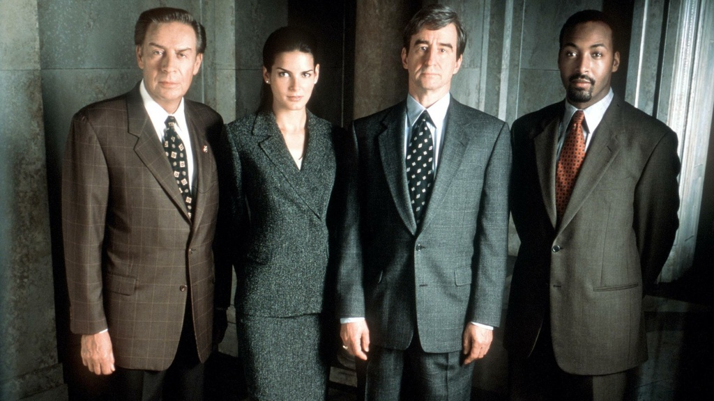 Jerry Orbach, Angie Harmon, Sam Waterston and Jesse L. Martin, from the 1999 cast of <em>Law & Order</em>.