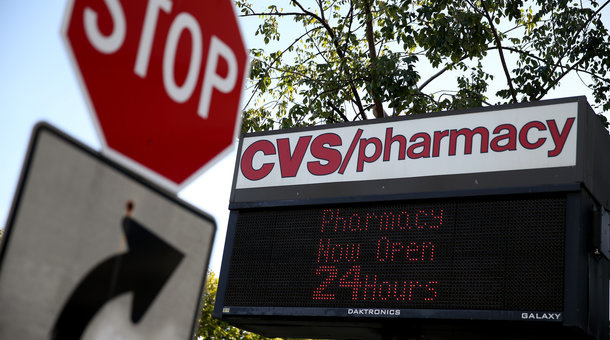 A stop sign is posted near CVS/pharmacy on February 5, 2014 in Miami, Florida.