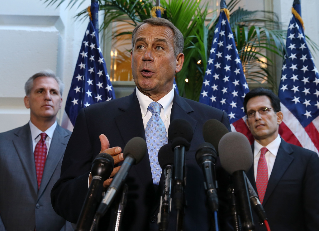 House Speaker John Boehner (R-OH) (C) speaks to the media while flanked by House Majority Leader Eric Cantor (R-VA) (R) and U.S.  Rep. Kevin McCarthy (R-CA) folowing a House Republican caucus meeting at the U.S. Capitol, October 15, 2013 in Washington, DC.