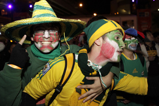 In this handout photo provided by Rick Stevens, Mexican and South African football fans celebrate the opening match of the 2010 World Cup between South Africa and Mexico at the Sydney International FIFA Fan Fest opening ceremony on June 11, 2010 in Sydney, Australia.
