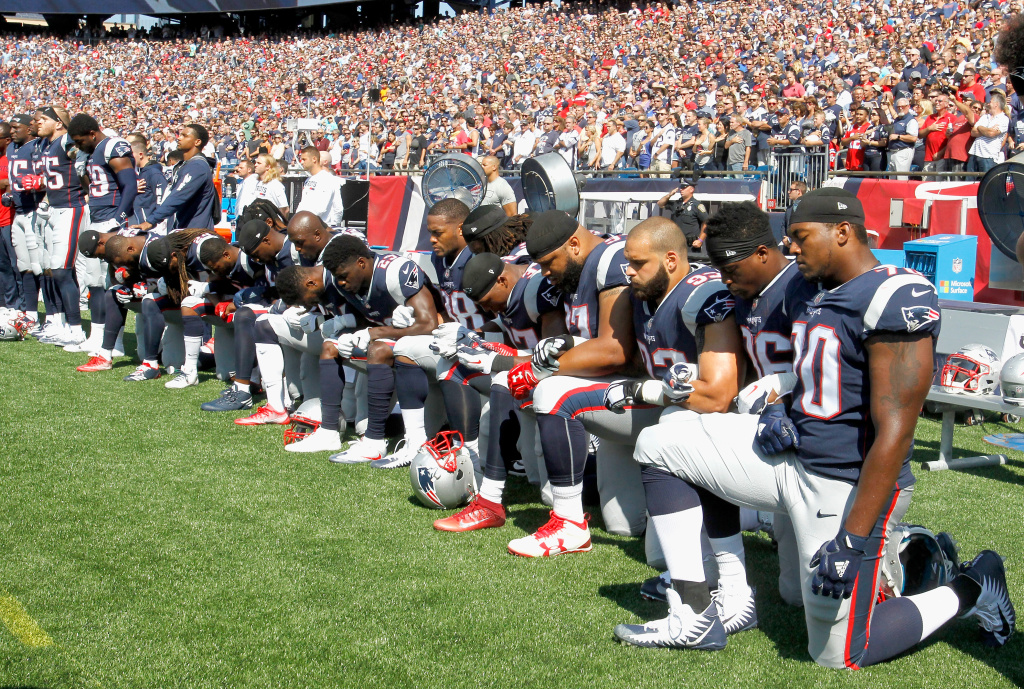 Members of the New England Patriots kneel during the national anthem before a game against the Houston Texans on September 24, 2017 in Foxboro, Massachusetts.
