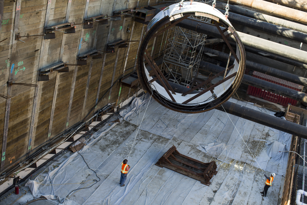 FILE PHOTO: A segment of a tunnel boring machine is lowered into the Regional Connector Transit Project in Little Tokyo on Wednesday morning, Oct. 29, 2016. It's one of the projects that has depended on federal dollars in part for construction.