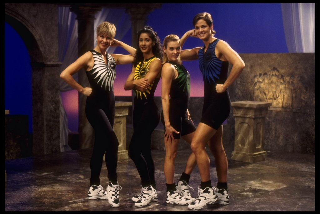 Models pose for a Reebok Aerobic Fitness Video on a classical indoor set.