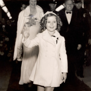 Child film star Shirley Temple (1928- ) arrives at