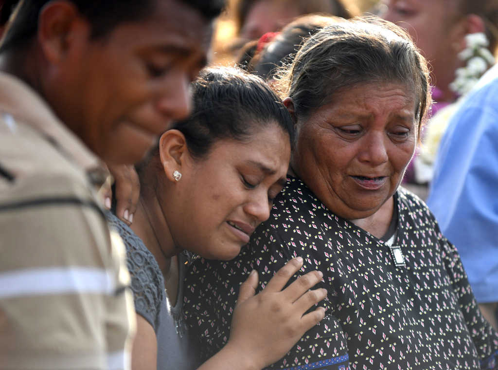 Mourners in Juchitan de Zaragoza, Oaxaca cry during the funeral of 85-year-old Casimiro Rey, one of the victims of an 8.1 earthquake that hit Mexico on September 8, 2017.