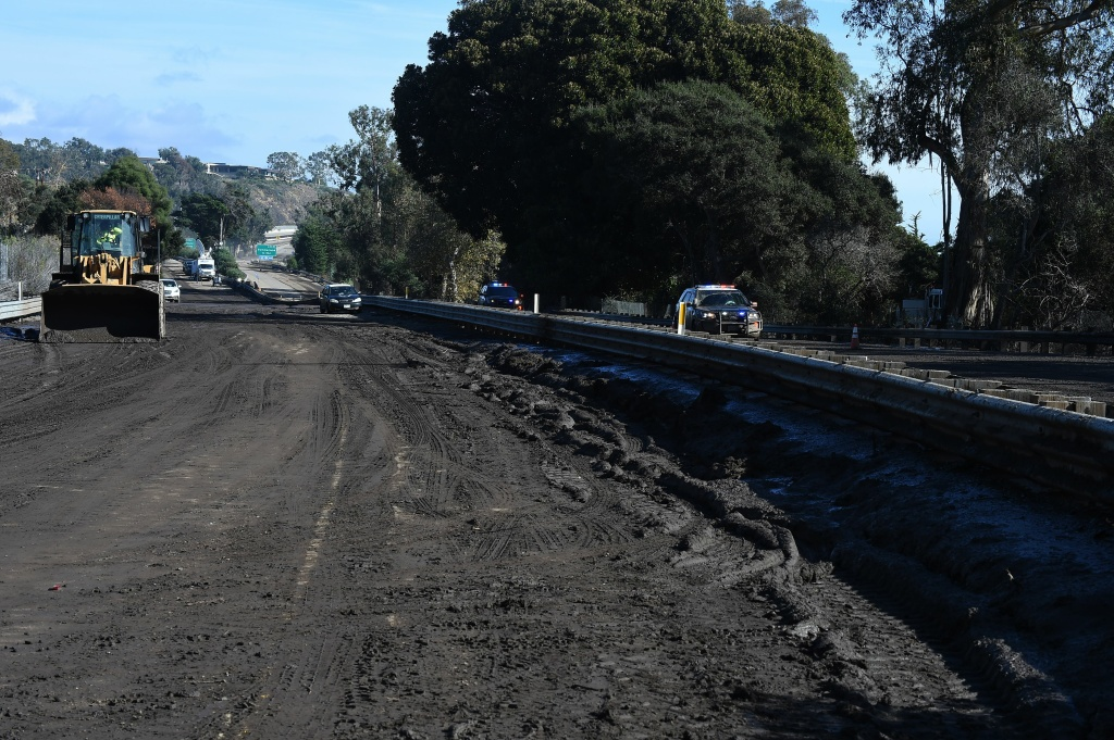 Crews expect to reopen US Highway 101 after mud and debris fill a section on January 10, 2018 after a massive mudflow in Montecito, California flooded the highway, causing a 30 mile long stretch to be closed.