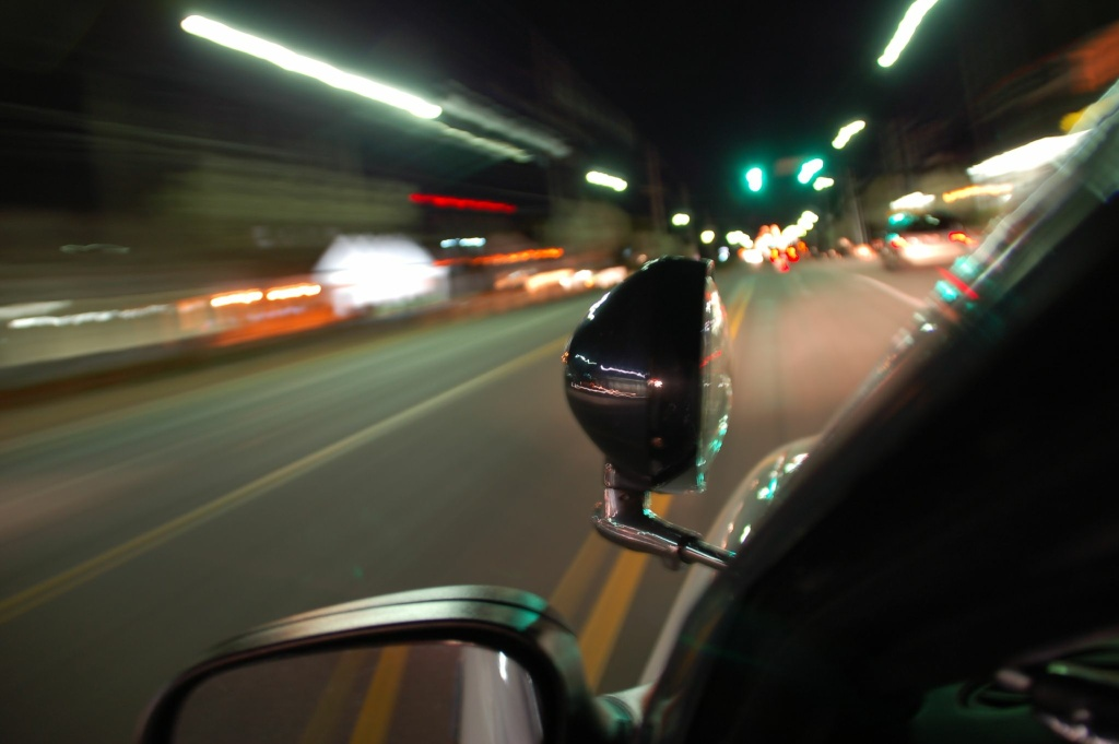 A police patrol car drives down an empty street. Dr. Henrik Minassian, associate professor of Urban Studies and Planning at CSUN, told KPCC he hopes two studies on human trafficking in the San Fernando Valley will help police reduce the number of working prostitutes in the area.
